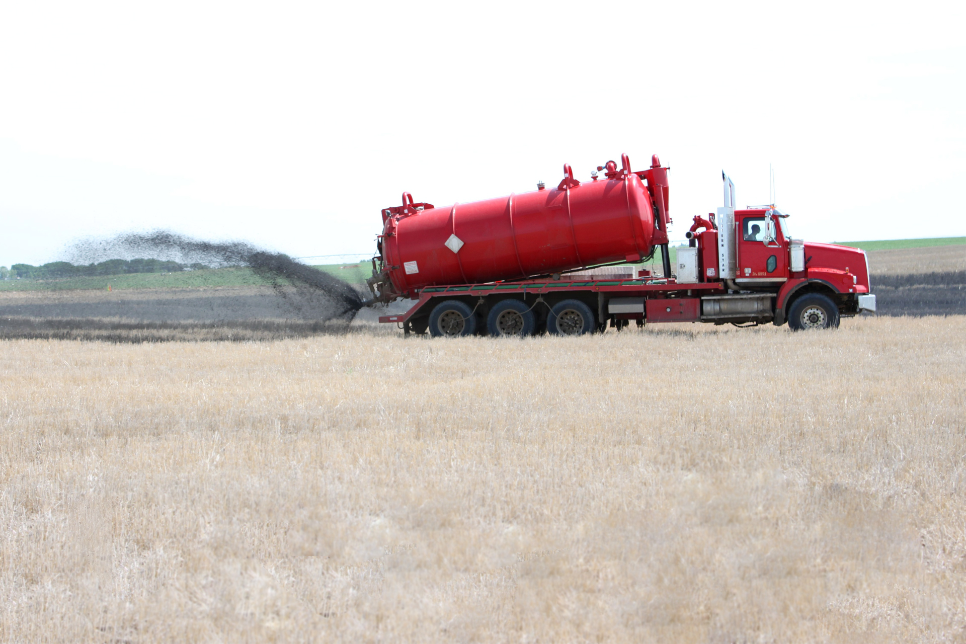 Drilling waste truck spray