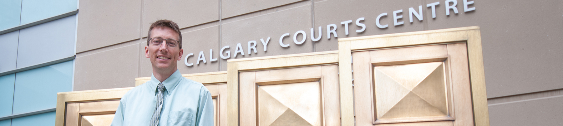 Greg Jones standing in front of the Calgary Courts